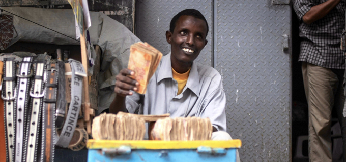 A money exchanger counts Somali shilling notes on the streets of the Somali capital Mogadishu.